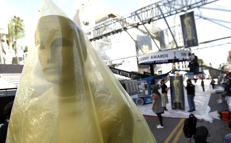 An Oscar statuette is seen the red carpet before the 84th Academy Awards in Los Angeles, Wednesday, Feb. 22, 2012. The Academy Awards will be held Sunday, Feb. 26, 2012. (AP Photo/Matt Sayles)