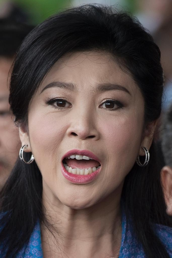 Deposed former Thai premier Yingluck Shinawatra poured subsidy into rice sector, winning the devotion of the so-called grassroots 'Red Shirt' pro-democracy movement (AFP Photo/Nicolas Asfouri)