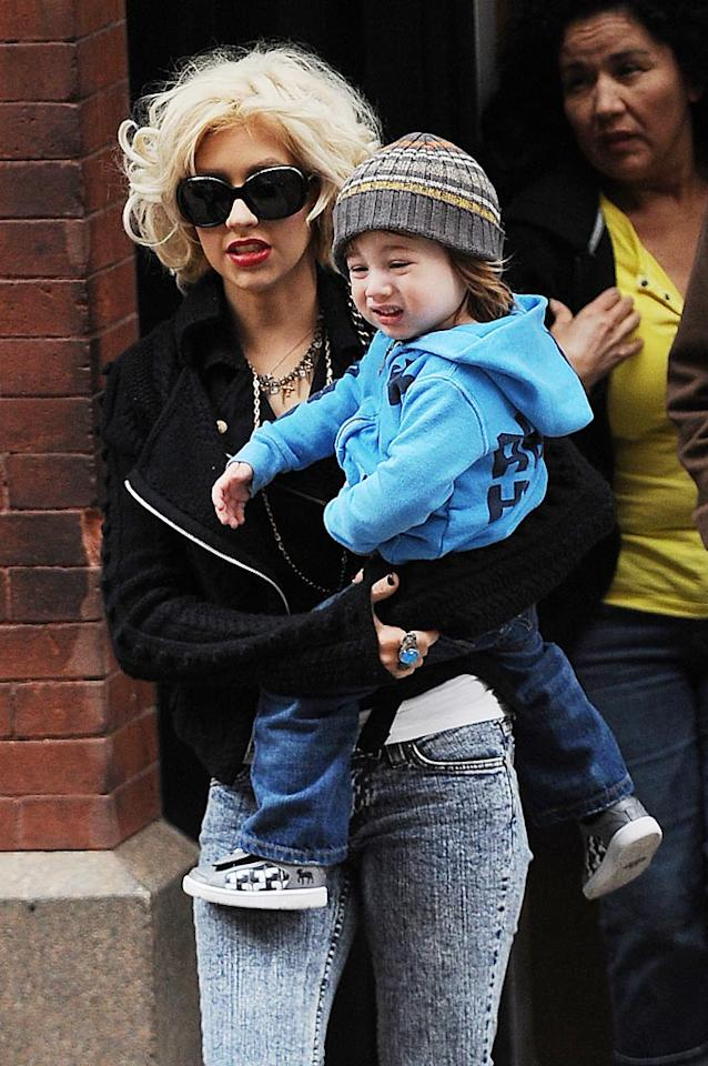 "Sporting the exact same facial expressions, Christina Aguilera and her little lookalike son Max were spotted out in NYC's Soho district on Sunday morning. <a href=""http://www.splashnewsonline.com"" target=""new"">Splash News</a> - May 9, 2010"