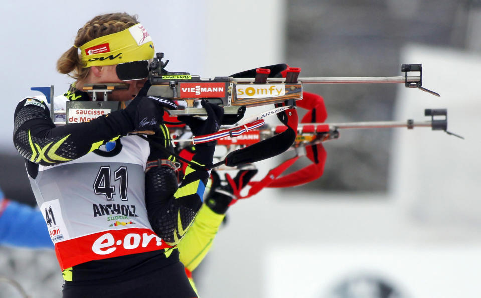 Anais Bescond, of France, competes in a women's Biathlon 7.5 kilometer sprint race in Anterselva, Italy, Thursday, Jan. 16, 2014. (AP Photo/Felice Calabro')