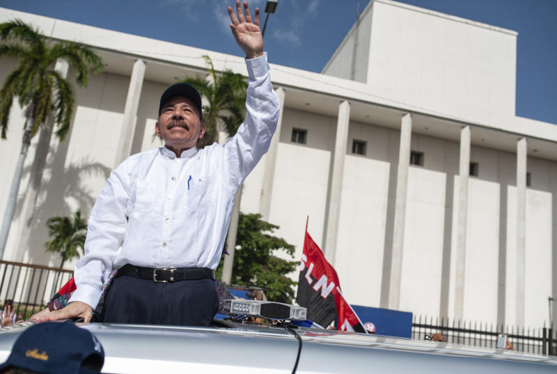 Nicaraguan President Daniel Ortega arrives to the Juan Pablo II plaza to celebrate the 39th anniversary of the Sandinista revolution, in Managua, Nicaragua, Thursday, July 19, 2018. Nicaragua marked anniversary of the 1979 revolution against dictator Anastasio Somoza, despite an ongoing political crisis that has seen hundreds killed in a government crackdown on protesters seeking President Daniel Ortega's exit from office. (AP Photo/Cristobal Venegas)