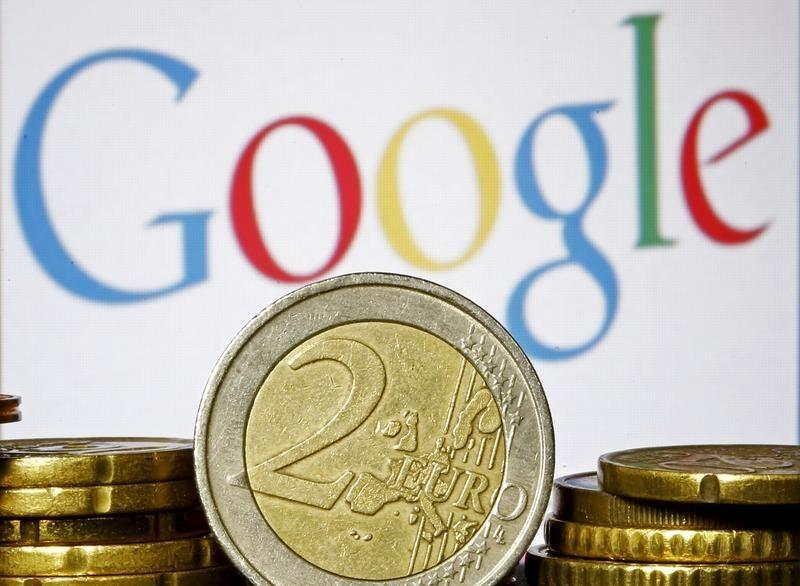 Euro coins are seen in front of a Google logo in this picture illustration taken in Zenica