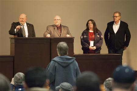 (L-R) Union leaders Mark Johnson, Tom Wroblewski, Susan Palmer and Rich Michalski announce the results of a union vote while speaking at the International Association of Machinists District 751 Headquarters in Seattle, Washington November 13, 2013. Boeing Co machinists soundly rejected an eight-year labour contract extension on Wednesday that would have let them build the company's newest jetliner in Washington, a historic decision that could forever alter the course of Boeing's 97-year presence in the state. International Association of Machinists members voted 67 percent against a deal that would secure an estimated 20 years of work building Boeing's 777X jet, but a deal that would have terminated their pension plan and raised their healthcare costs. REUTERS/David Ryder