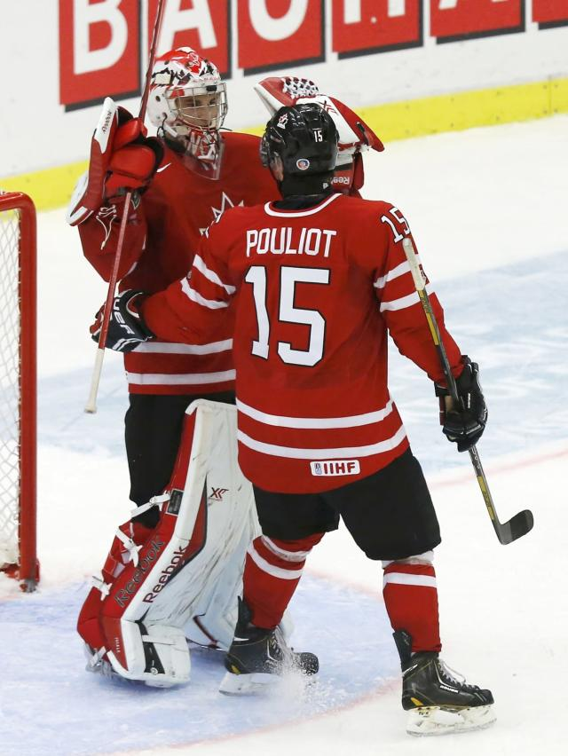 Canada's goalie Zachary Fucale (L) raises his arms with teammate Derrick Pouliot after Canada defeated the United States in their IIHF World Junior Championship ice hockey game in Malmo, Sweden, December 31, 2013. REUTERS/Alexander Demianchuk (SWEDEN - Tags: SPORT ICE HOCKEY)