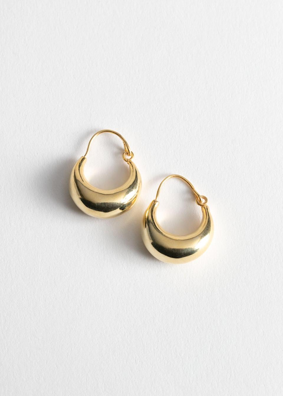 "<br><br><strong>& Other Stories</strong> Droplet Hoop Earrings, $, available at <a href=""https://go.skimresources.com/?id=30283X879131&url=https%3A%2F%2Fwww.stories.com%2Fen_usd%2Fjewellery%2Fearrings%2Fhoops%2Fproduct.droplet-hoop-earrings-gold.0770931001.html"" rel=""nofollow noopener"" target=""_blank"" data-ylk=""slk:& Other Stories"" class=""link rapid-noclick-resp"">& Other Stories</a>"