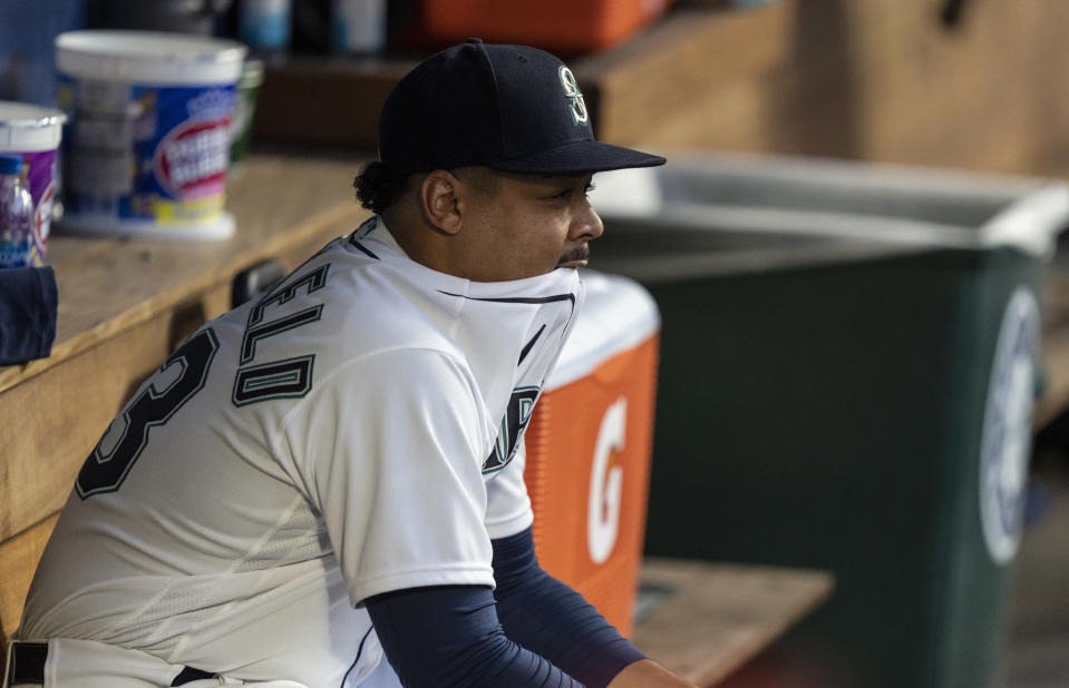 Seattle Mariners starting pitcher Justus Sheffield sits in the dugout after giving up two home runs during the fifth inning of the team's baseball game against the Minnesota Twins, Wednesday, June 16, 2021, in Seattle. (AP Photo/Stephen Brashear)