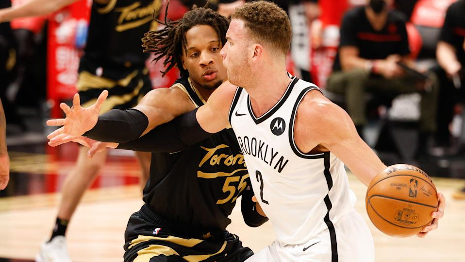 Apr 27, 2021; Tampa, Florida, USA;  aToronto Raptors forward Freddie Gillespie (55) atempts to steal the ball from Brooklyn Nets forward Blake Griffin (2) in the third quarter at Amalie Arena. Mandatory Credit: Nathan Ray Seebeck-USA TODAY Sports - 15975407