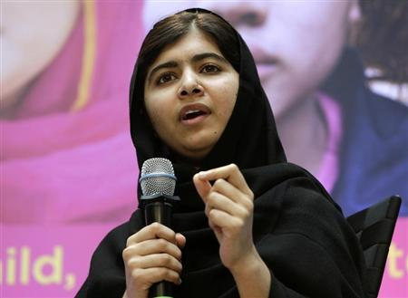 Malala Yousafzai speaks during a news conference with World Bank President Jim Yong Kim, celebrating International Day of the Girl in Washington
