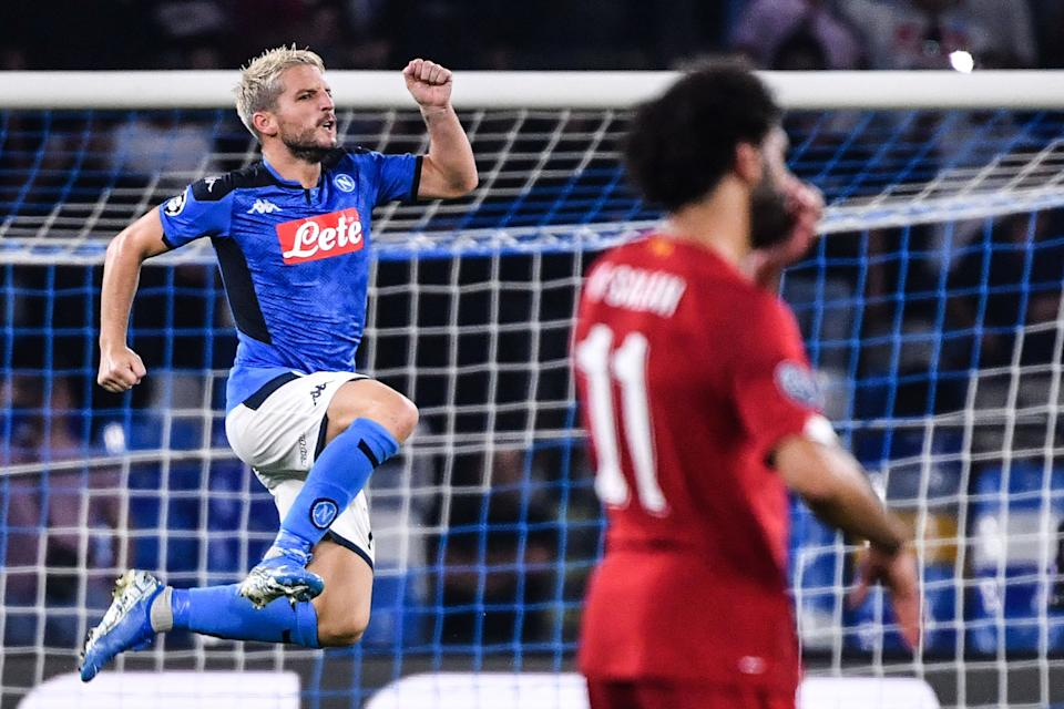 Napoli's Belgian forward Dries Mertens celebrates next to Liverpool's Egyptian midfielder Mohamed Salah after scoring a penalty during the UEFA Champions League Group E football match Napoli vs Liverpool on September 17, 2019 at the San Paolo stadium in Naples. (Photo by Alberto PIZZOLI / AFP)        (Photo credit should read ALBERTO PIZZOLI/AFP/Getty Images)