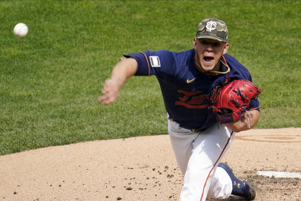 Minnesota Twins pitcher Jose Berrios throws against the Oakland Athletics in the first inning of a baseball game, Saturday, May 15, 2021, in Minneapolis. (AP Photo/Jim Mone)