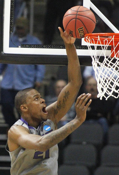 Kansas State's Jordan Henriquez lays in a basket in the first half of an East Regional NCAA tournament second-round college basketball game against Southern Mississippi on Thursday, March 15, 2012, in Pittsburgh. (AP Photo/Keith Srakocic)