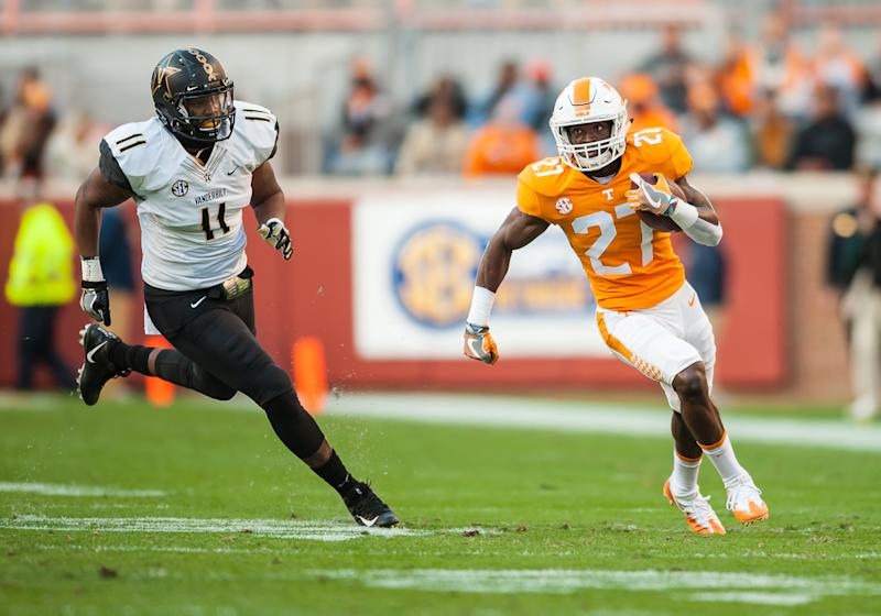 KNOXVILLE, TN - NOVEMBER 25: Tennessee Volunteers running back Carlin Fils-aime (27) runs past Vanderbilt Commodores linebacker Charles Wright (11) during a game between the Vanderbilt Commodores and Tennessee Volunteers on November 25, 2017, at Thompson-Boling Arena in Knoxville, TN. (Photo by Bryan Lynn/Icon Sportswire via Getty Images)