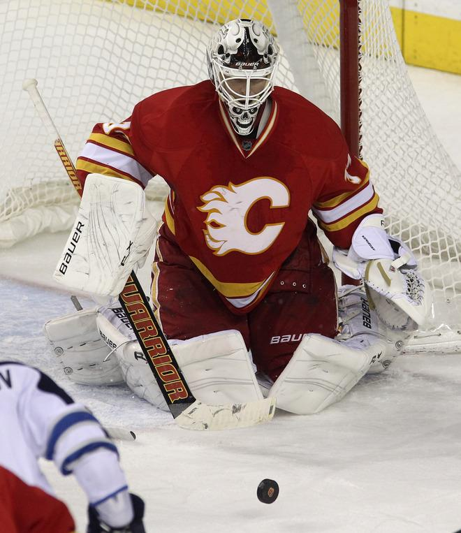 CALGARY, CANADA - MARCH 9: Miikka Kiprusoff #34 of the Calgary Flames defends against one of 45 shots taken against him during NHL action against the Winnipeg Jets on March 9, 2012 at the Scotiabank Saddledome in Calgary, Alberta, Canada. (Photo by Mike Ridewood/Getty Images)