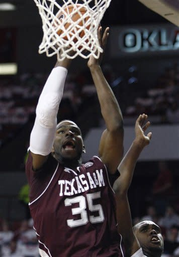 Texas A&M forward Ray Turner (35) shoots in front of Oklahoma forward Andrew Fitzgerald (4) during the first half of an NCAA college basketball game in Norman, Okla., Saturday, March 3, 2012. (AP Photo/Alonzo Adams)