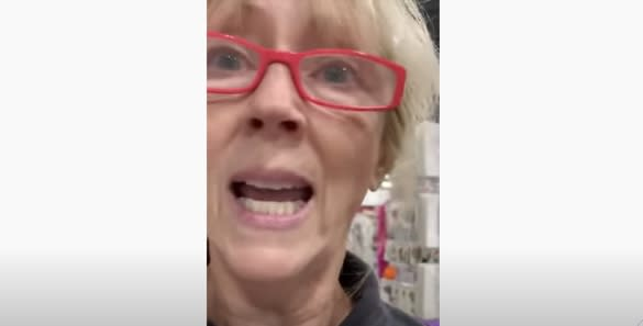 A woman who walked into a Calgary Fabricland and was told by employees that she had to wear a mask got into a confrontation with staff and other customers, including one who recorded her outburst. (YouTube)