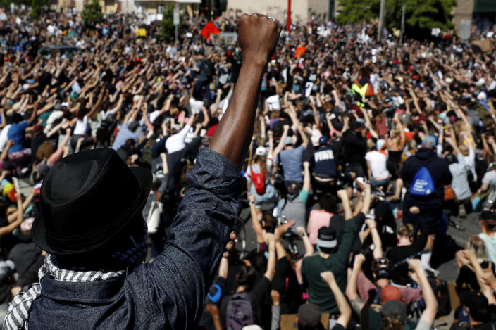 Image: Protesters raise their fist during a demonstration in Minneapolis on May 30, 2020. (John Minchillo / AP)