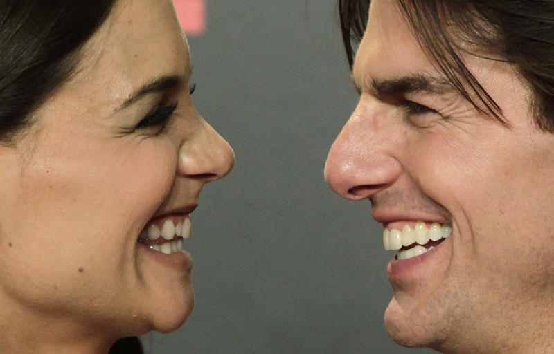 """FILE - Actor Tom Cruise and his wife Katie Holmes pose during a photo-call for the world premiere of their new film """"Knight and Day"""" at the Lope de Vega theatre in Seville, Spain on Wednesday June 16, 2010. Cruise and Homes are calling it quits after five years of marriage. Holmes' attorney Jonathan Wolfe said Friday June 29, 2012 that the couple is divorcing, but called it a private matter for the family. (AP Photo/Toni Rodriguez)"""