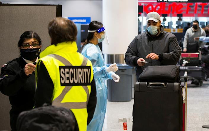 TORONTO, Feb. 1, 2021 -- A traveller wearing a face mask shows his test certificate at the exit of a COVID-19 testing site at Toronto International Airport in Mississauga, Ontario, Canada, on Feb. 1, 2021. Canada's Ontario required all international arriving passengers to take a COVID-19 test upon arrival starting on Monday to stop the spread of COVID-19 variants. (Photo by Zou Zheng/Xinhua via Getty) (Xinhua/Zou Zheng via Getty Images)