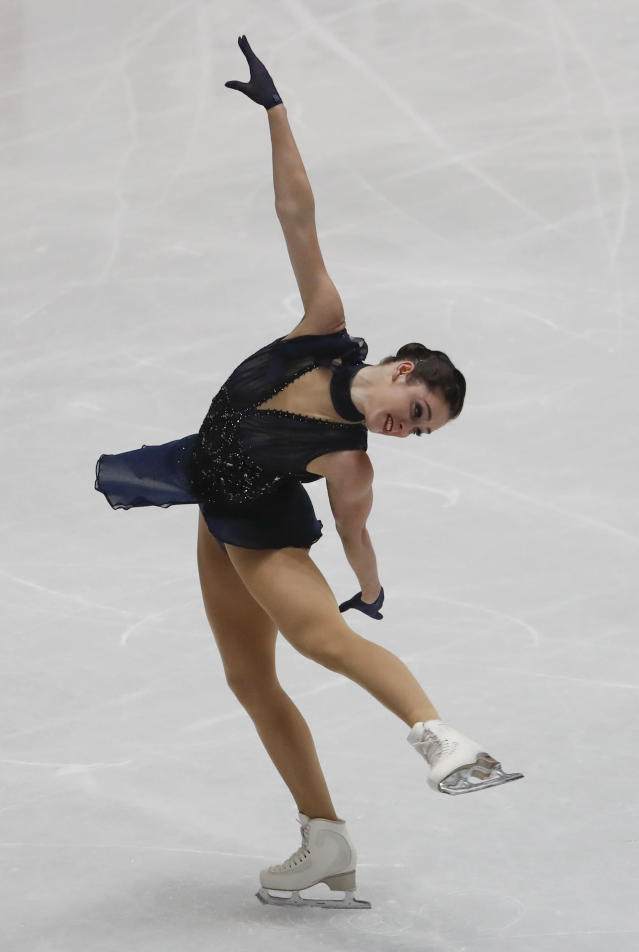 Kaetlyn Osmond of Canada performs during women's short program at the Figure Skating World Championships in Assago, near Milan, Wednesday, March 21, 2018. (AP Photo/Antonio Calanni)