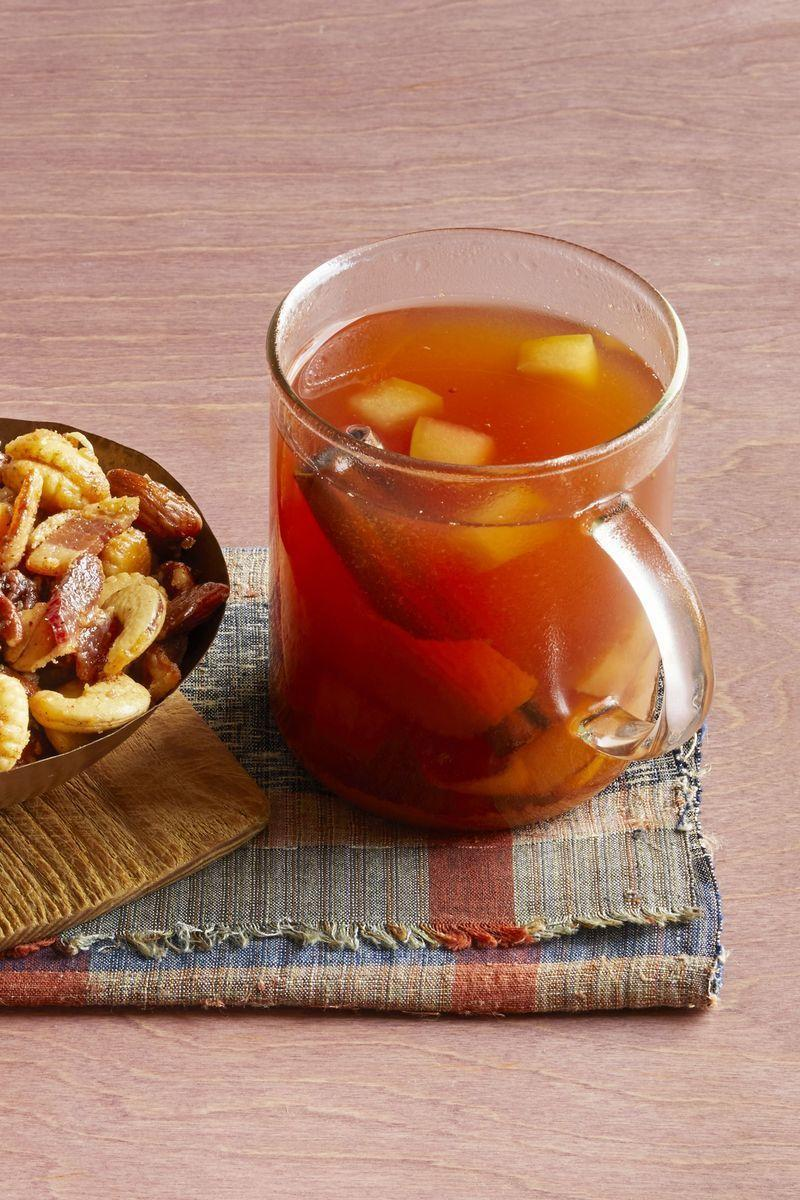"""<p>This warm cider with a splash of bourbon is the best way to wind down after Halloween festivities. Sip this cozy cider while watching your favorite <a href=""""https://www.thepioneerwoman.com/news-entertainment/g33607802/classic-halloween-movies/"""" rel=""""nofollow noopener"""" target=""""_blank"""" data-ylk=""""slk:Halloween movie"""" class=""""link rapid-noclick-resp"""">Halloween movie</a>. </p><p><a href=""""https://www.thepioneerwoman.com/food-cooking/recipes/a32304617/mulled-cider-with-bourbon-recipe/"""" rel=""""nofollow noopener"""" target=""""_blank"""" data-ylk=""""slk:Get the recipe."""" class=""""link rapid-noclick-resp""""><strong>Get the recipe.</strong></a></p><p><a class=""""link rapid-noclick-resp"""" href=""""https://go.redirectingat.com?id=74968X1596630&url=https%3A%2F%2Fwww.walmart.com%2Fip%2FThe-Pioneer-Woman-Toni-17-Ounce-Red-Mugs-4-Pack%2F648137736&sref=https%3A%2F%2Fwww.thepioneerwoman.com%2Fholidays-celebrations%2Fg36792938%2Fhalloween-punch-recipes%2F"""" rel=""""nofollow noopener"""" target=""""_blank"""" data-ylk=""""slk:SHOP MUGS"""">SHOP MUGS</a></p>"""