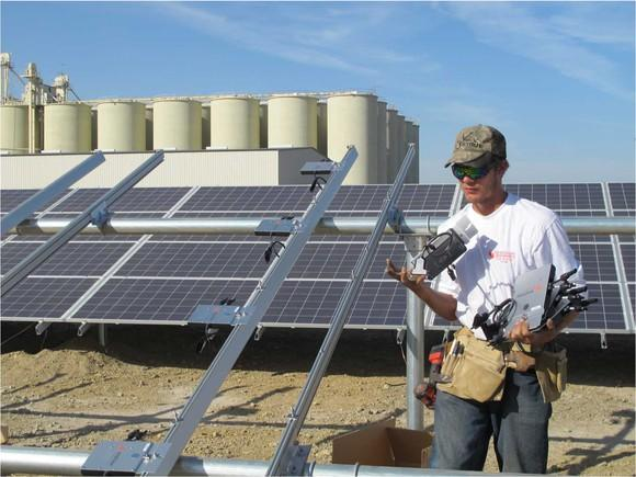 Worker mounting structure to hold tilted solar panels.