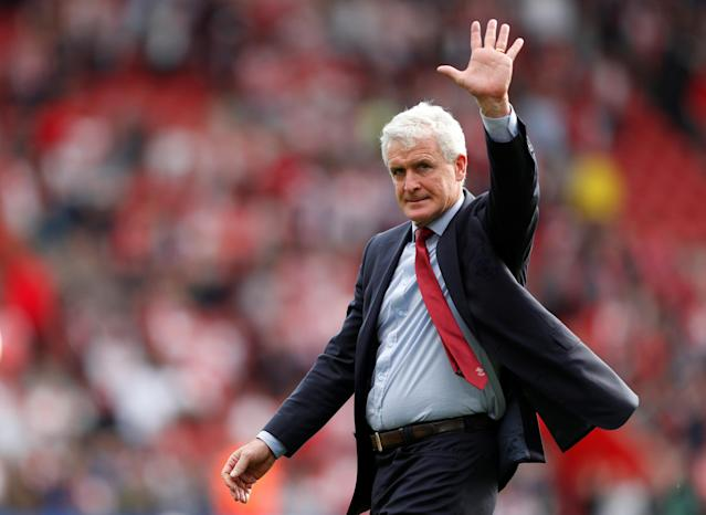 "Soccer Football - Premier League - Southampton vs Manchester City - St Mary's Stadium, Southampton, Britain - May 13, 2018 Southampton manager Mark Hughes waves to fans during a lap of appreciation after the match Action Images via Reuters/John Sibley EDITORIAL USE ONLY. No use with unauthorized audio, video, data, fixture lists, club/league logos or ""live"" services. Online in-match use limited to 75 images, no video emulation. No use in betting, games or single club/league/player publications. Please contact your account representative for further details."