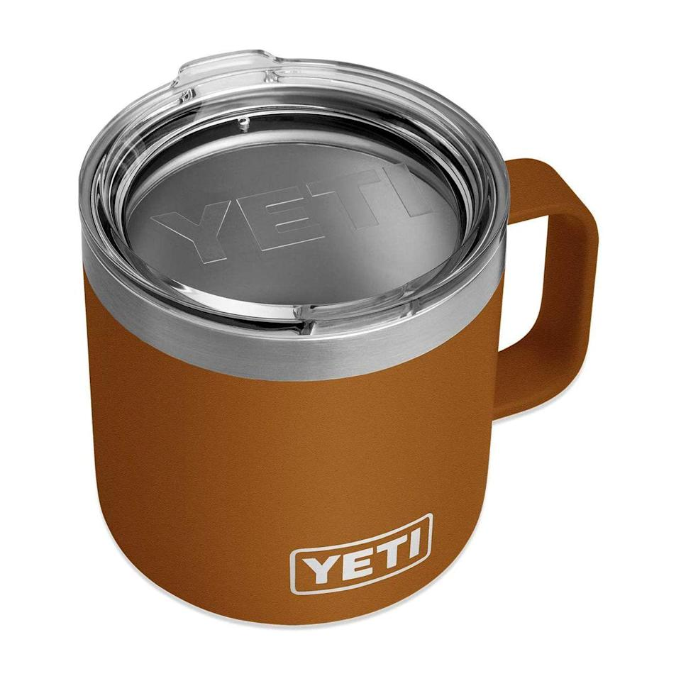 """<p><strong>YETI</strong></p><p>amazon.com</p><p><strong>$40.71</strong></p><p><a href=""""https://www.amazon.com/dp/B07VHKLJF8?tag=syn-yahoo-20&ascsubtag=%5Bartid%7C2141.g.27288061%5Bsrc%7Cyahoo-us"""" rel=""""nofollow noopener"""" target=""""_blank"""" data-ylk=""""slk:Shop Now"""" class=""""link rapid-noclick-resp"""">Shop Now</a></p><p>If your dad is an essential worker (or just happens to be in the car a lot), hook him up with this insulated YETI mug that'll keep his <a href=""""https://www.prevention.com/food-nutrition/a30570113/is-coffee-healthy/"""" rel=""""nofollow noopener"""" target=""""_blank"""" data-ylk=""""slk:coffee hot"""" class=""""link rapid-noclick-resp"""">coffee hot</a> and his iced tea cold, just like he likes it.</p>"""
