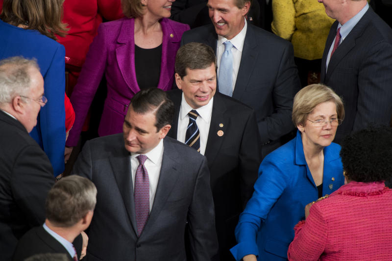 UNITED STATES - JANUARY 28: From left, Sens. Ted Cruz, R-Texas, Mark Begich, D-Alaska, Jeff Flake, R-Ariz., and Elizabeth Warren, D-Mass., greet members of Congress upon arriving in the House Chamber of the Capitol to hear President Barack Obama deliver his State of the Union address. (Photo By Tom Williams/CQ Roll Call)