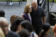 Oregon Governor Kate Brown, left, poses with Hector Calderon, the state's first COVID-19 patient, after announcing the end of the state's COVID-19 restrictions in Portland, Ore., Wednesday, June 30, 2021. (AP Photo/Craig Mitchelldyer)