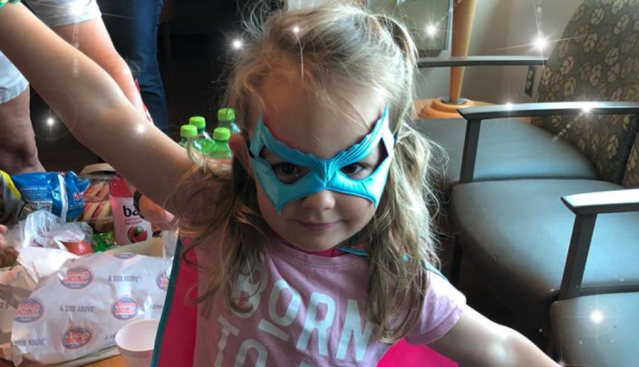 Molly McCabe isn't just dressed as a superhero; the 3-year-old proved to be one after she saved her dad's life when he suffered a stroke. (Photo: Devon McCabe via Facebook)