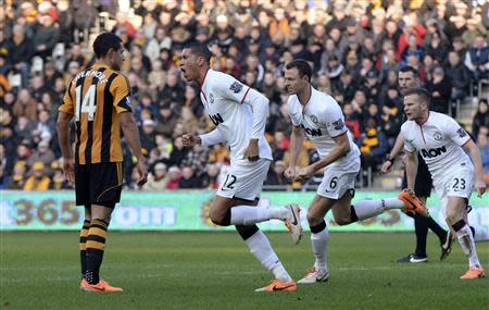 Manchester United's Chris Smalling (2nd L) celebrates after scoring a goal against Hull City during their English Premier League soccer match at the KC Stadium in Hull, northern England, December 26, 2013. REUTERS/Nigel Roddis