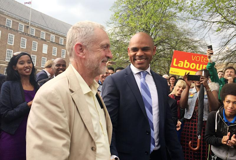 Leader of the Labour Party Jeremy Corbyn (left) with Labour's Marvin Rees who has been elected as the mayor of Bristol, ousting George Ferguson from the role, during a walk about at College Green, Bristol.