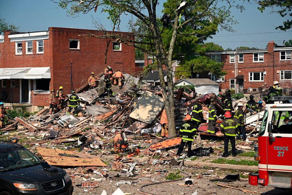 Firefighters search what remains of homes that were destroyed in a gas explosion Monday at Boxhill Road and Reisterstown Road in Northeast Baltimore. (Photo: ASSOCIATED PRESS)