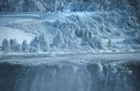 <p>A lone visitor on the United States side of the Niagara River watches as ice chunks and water flow over the brink of the Horseshoe Falls in Niagara Falls, Ontario, Canada, January 3, 2018. REUTERS/Aaron Lynett </p>