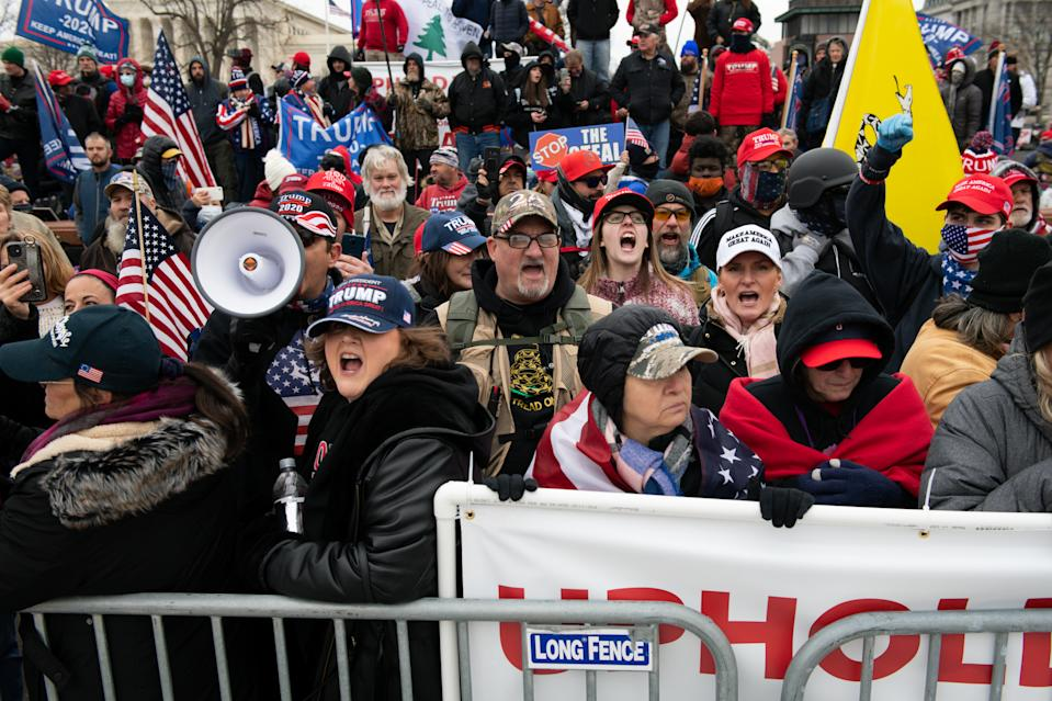 Demonstrators gather during a protest outside of the U.S. Capitol building in Washington, D.C. on Wednesday. (Graeme Sloan/Bloomberg via Getty Images)