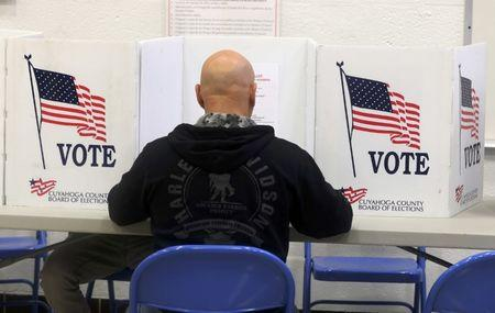 A voters casts his ballot during the U.S. presidential election in Ohio