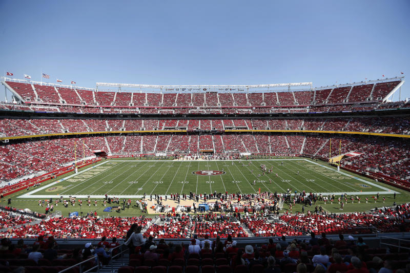 FILE - In this Oct. 7, 2018, file photo, fans watch an NFL football game between the San Francisco 49ers and the Arizona Cardinals at Levi's Stadium in Santa Clara, Calif. With the College Football Playoff title game located thousands of miles away from the two campuses in Alabama and South Carolina, possible fatigue for fan bases of teams that have become annual participants in the playoff and a game site in an expensive market lacking college football die-hards, prices for tickets for Monday night's championship game in Santa Clara have been plummeting the past few days. (AP Photo/Tony Avelar)