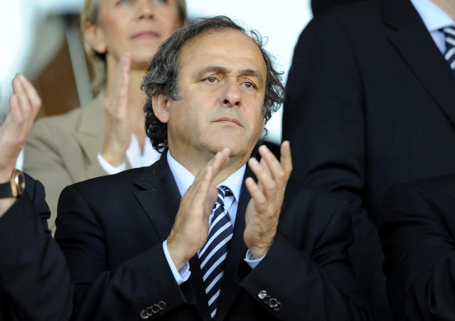UEFA President Michel Platini (C) applauds ahead of the UEFA Under-21 European Championship football final match at NRGI Park Stadium in Arhus Stadion Denmark on June 25, 2011. AFP PHOTO CLAUS FISKER/SCANPIX (Photo credit should read CLAUS FISKER/AFP/Getty Images)