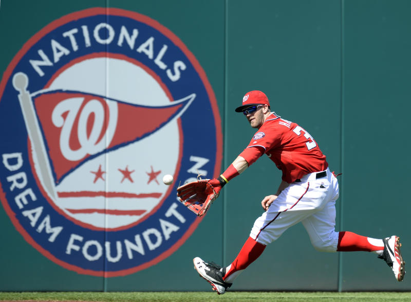 Washington Nationals left fielder Bryce Harper (34) fields a ball hit by Philadelphia Phillies' Roger Bernadina, who scored a double on the play, during the third inning of their baseball game at Nationals Park in Washington, Sunday, Sept. 15, 2013. (AP Photo/Susan Walsh)