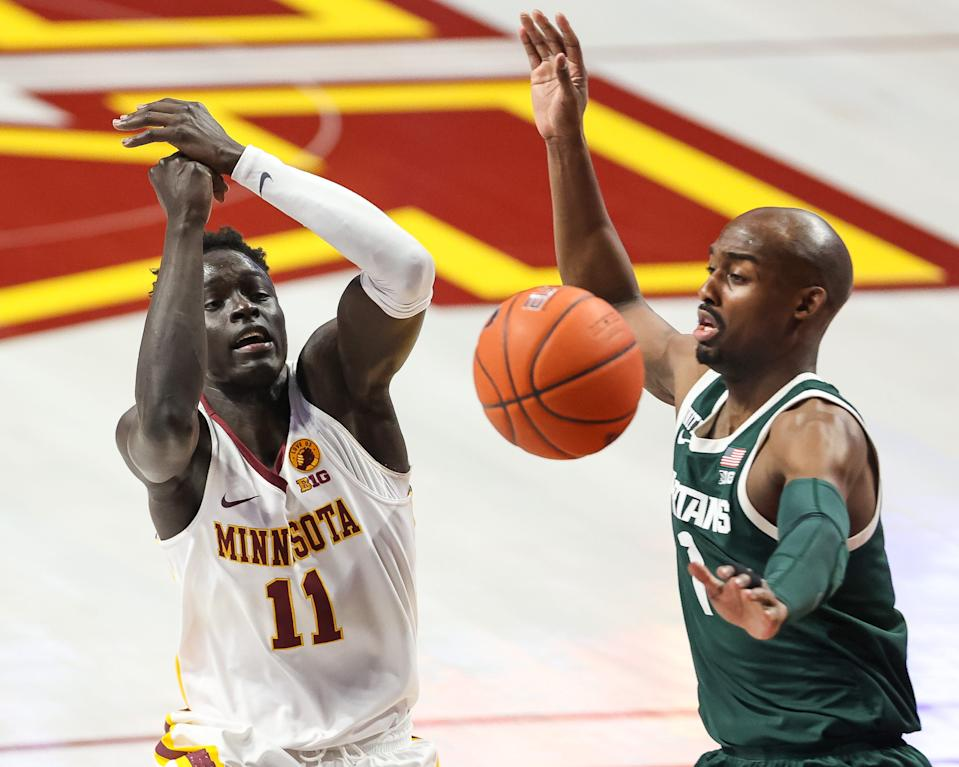 Dec 28, 2020; Minneapolis, Minnesota, USA; Michigan State Spartans guard Joshua Langford (1) knocks the ball away from Minnesota Gophers guard Both Gach (11) during the first half at Williams Arena.