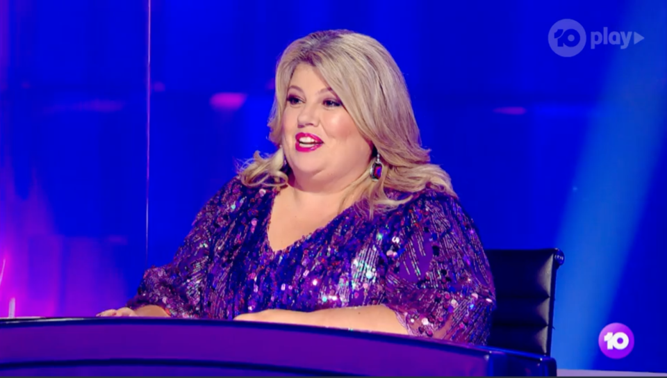 Urzila Carlson on The Masked Singer wearing a purple sparkly dress