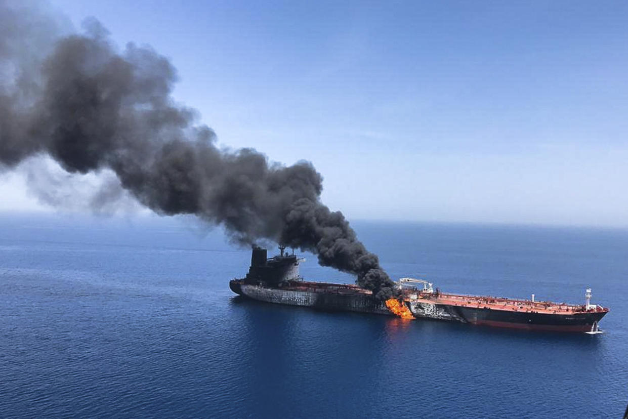 FILE - In this Thursday, June 13, 2019 file photo, an oil tanker is on fire in the sea of Oman. A series of attacks on oil tankers near the Persian Gulf has ratcheted up tensions between the U.S. and Iran -- and raised fears over the safety of one of Asia's most vital energy trade routes, where about a fifth of the world's oil passes through its narrowest at the Strait of Hormuz. The attacks have jolted the shipping industry, with many of operators in the region on high alert. (AP Photo/ISNA, File)