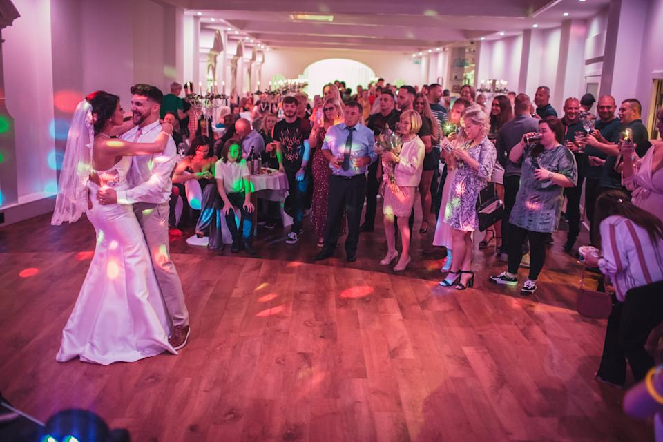 A couple shocked guests by holding a secret wedding at their engagement celebration (SWNS)