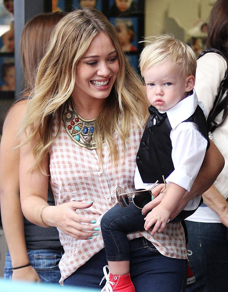 Hilary Duff smiled as she carried son Luca after his graduating ceremony at Babies First Class in Los Angeles