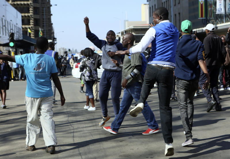 Protestors gather on the streets in Harare, Friday, Aug. 16, 2019. The main opposition Movement For Democratic Change party is holding protests over deteriorating economic conditions in the country as well as to try and force Zimbabwean President Emmerson Mnangagwa to set up a transitional authority to address the crisis and organize credible elections.(AP Photo/Tsvangirayi Mukwazhi)