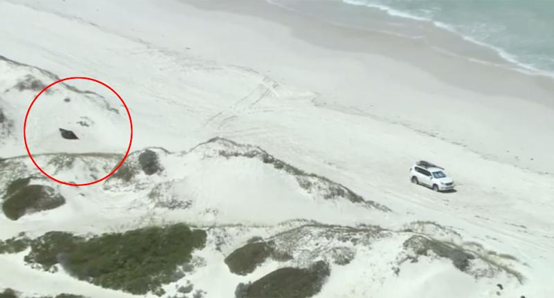 A tent is pictured on White Island beach near a 4WD.