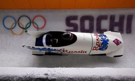 FILE PHOTO: Russia's pilot Olga Stulneva and Liudmila Udobkina speed down the track during the women's bobsleigh competition at the 2014 Sochi Winter Olympics February 18, 2014. REUTERS/Arnd Wiegmann/File Photo