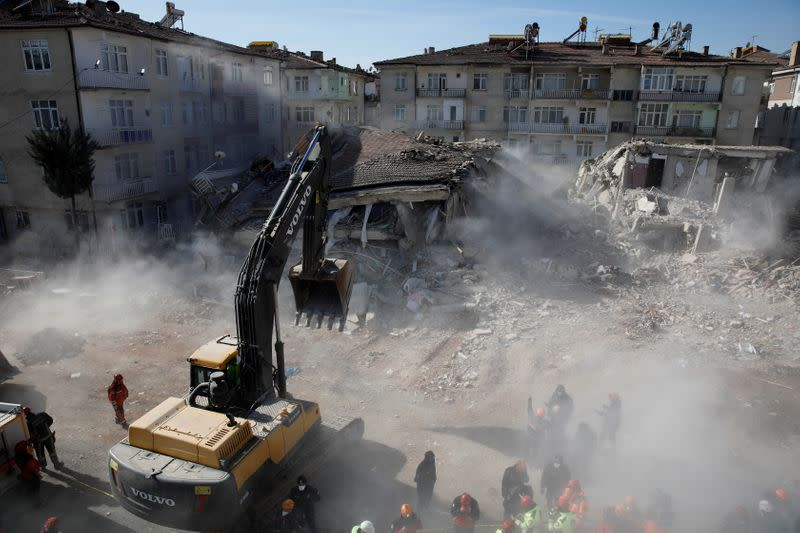 Emergency personnel work at the site of damaged buildings after an earthquake in Elazig
