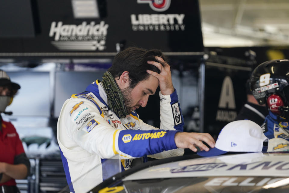 NASCAR Cup Series driver Chase Elliott reacts after ending his race during a NASCAR Cup Series at Atlanta Motor Speedway on Sunday, March 21, 2021, in Hampton, Ga. (AP Photo/Brynn Anderson)
