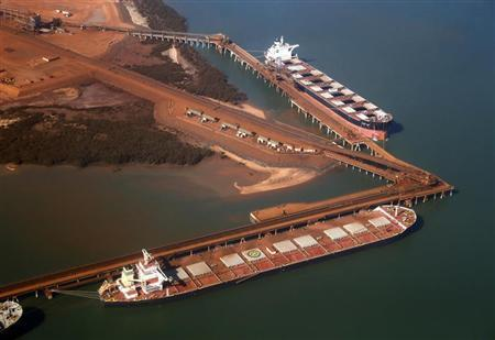 Ships waiting to be loaded with iron ore are seen at the Fortescue loading dock located at Port Hedland